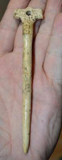A very large and extremely rare Neolithic ornately carved bone cloak pin. SOLD